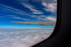 Aerial view of blue sky with clouds from windowjet flight Stock Image