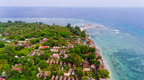 Aerial view of the blue water coast line in Gili Air island. Bali, Indonesia royalty free stock image