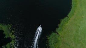 Aerial view of boat in beautiful lake. Aerial view of boat floating in beautiful lake stock video footage