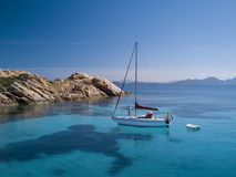 Aerial view of a boat in front of the Mortorio island in Sardinia. Amazing beach with a turquoise and transparent sea. Emerald Coa Stock Image