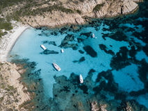 Aerial view of a boat in front of the Mortorio island in Sardinia. Amazing beach with a turquoise and transparent sea. Emerald Coa Royalty Free Stock Photos