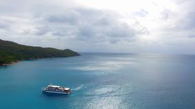 Aerial View Of A Boat In The Ocean 2. Drone Shot Of A Boat In The Indian Ocean, Anse Lazio,Praslin Island, Seychelles stock video footage