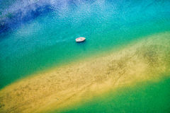 Aerial view of boat in ocean. Aerial view of boat, sea and sand bank Royalty Free Stock Photos
