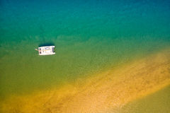 Aerial view of boat in ocean. Aerial view of boat, sea and sand bank Stock Images