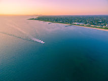 Aerial view of boat sailing across Port Phillip bay with Melbour Stock Photos