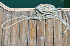 Aerial view of a boat tied to a wooden pier Stock Image
