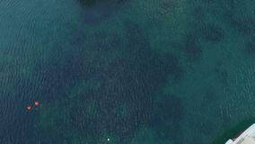 Aerial view of boats in the crystal clear water.  stock video footage