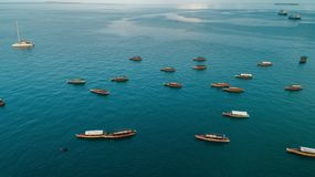 Aerial view of the boats and dhow,  stone town in Zanzibar. Aerial view of the boats and dhow, stone town in Zanzibar stock images