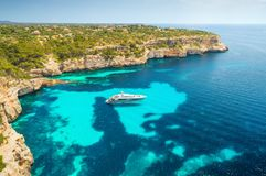 Aerial view of boats, luxury yachts and transparent sea. Aerial view of white luxury yacht and transparent sea at sunny day in Mallorca, Spain. Colorful summer Royalty Free Stock Photo