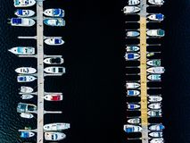 Aerial view of boats, yachts, water bike and wooden sauna in a marina in Finland. Aerial view of boats, yachts, water bike and wooden sauna in a marina in summer stock photography