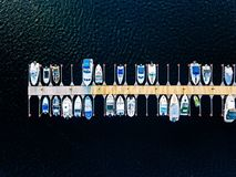 Aerial view of boats, yachts, water bike and wooden sauna in a marina in Finland. Aerial view of boats, yachts, water bike and wooden sauna in a marina in summer royalty free stock image