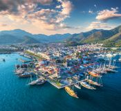 Aerial view of boats and yahts and beautiful city at sunset Royalty Free Stock Photos