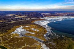 Aerial View of Body of Water, Land Formation, and Mountain royalty free stock photo