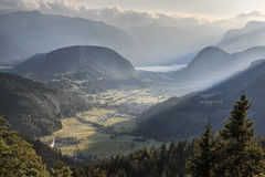 Aerial view of Bohinj lake at sunset in Julian Alps. Popular touristic destination in Slovenia not far from Lake Bled. Aerial view of Bohinj lake at sunset in Royalty Free Stock Image