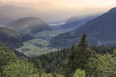 Aerial view of Bohinj lake at sunset in Julian Alps. Popular touristic destination in Slovenia not far from Lake Bled. Aerial view of Bohinj lake at sunset in Stock Photos