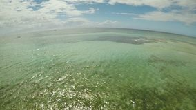 Aerial view of Bohol coast Island. Aerial. Flight is close above the water. Fisheye view. Philippines. Aerial view of Bohol coast Island. Aerial. Fisheye view stock footage