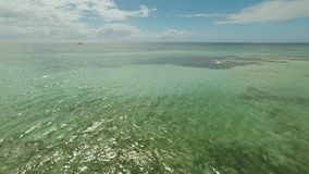 Aerial view of Bohol coast Island. Aerial. Flight is close above the water. Philippines. Aerial view of Bohol coast Island. Aerial. Flight is close above the stock footage