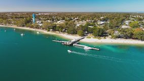 Aerial view of Bongaree Jetty on Bribie Island, Australia stock footage