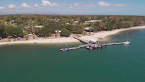 Aerial view of Bongaree Jetty on Bribie Island, Sunshine Coast, Australia. Aerial view of Bongaree Jetty on Bribie Island, Sunshine Coast, Queensland, Australia stock video footage