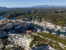 Aerial view of Bonifacio old town built on cliffs of white limestone, cliffs. Harbor. Corsica, France Royalty Free Stock Photo