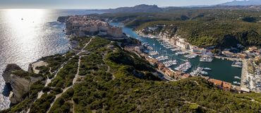 Aerial view of Bonifacio old town built on cliffs of white limestone, cliffs. Harbor. Corsica, France Stock Image