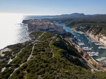 Aerial view of Bonifacio old town built on cliffs of white limestone, cliffs. Harbor. Corsica, France Royalty Free Stock Photography
