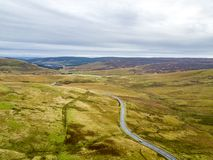 Aerial view of the border between Scotland and England with large stone and Scotland sign - United Kingdom.  royalty free stock photo