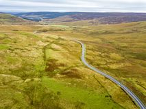 Aerial view of the border between Scotland and England with large stone and Scotland sign - United Kingdom.  royalty free stock images