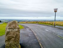 Aerial view of the border between Scotland and England with large stone and Scotland sign - United Kingdom.  stock photography