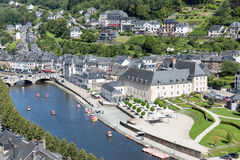 Aerial view Bouillon with pedalos in river Semois, Belgium. BOUILLON, BELGIUM - AUG 13: Aerial view of medieval city Bouillon with pedalos in river Semois on stock images