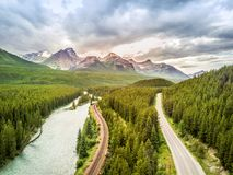 Aerial view of Bow river among canadian Rockies Mountains, Banff National Park, Alberta, Canada. Aerial view of Bow river, railway and road among canadian stock image