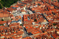 Aerial view of Brasov city in Romania. Tilt shift lens effect Stock Photos
