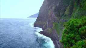 Aerial view of Bride Veil Waterfall and the north coast in Madeira stock footage