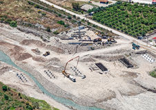 Aerial view of a bridge construction site. Aerial view of a bridge construction site with machinery stock photo