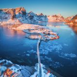 Aerial view of bridge over the sea and snowy mountains in Norway Royalty Free Stock Image