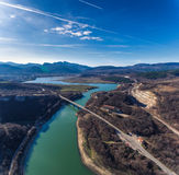 Aerial view of Bridge road near lake in mountain landscape.  Stock Photo