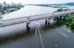 Aerial view of the bridge and the road over the Dnepr River over a green island in the middle of the river Stock Image