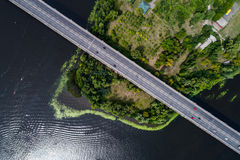 Aerial view of the bridge and the road over the Dnepr River over a green island in the middle of the river Royalty Free Stock Photos