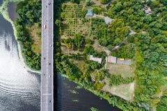 Aerial view of the bridge and the road over the Dnepr River over a green island in the middle of the river Royalty Free Stock Image