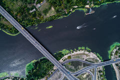 Aerial view of the bridge and the road over the Dnepr River over a green island in the middle of the river Stock Photos