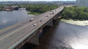 Flying over bridge with transport on it. Aerial view of bridge with transport on it stock video
