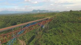 Aerial view of bridge in West Java, Indonesia. Aerial view of new and old train bridges above forest in West Java, Indonesia stock video