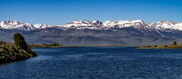 Aerial View of Bridgeport Reservoir, California in late spring. With blue sky, water and snow capped mountains royalty free stock photos