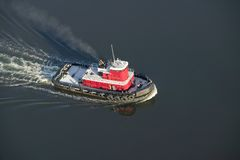 A aerial view of a bright red tug boat outside of Portland Maine Stock Photo