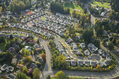 Aerial View of Bright Suburban Neighborhood. Evening sun shining on a suburban neighborhood in Washington Royalty Free Stock Images