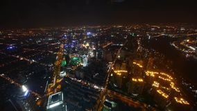 Aerial view of brightly lit buildings with river in Shanghai at night,timelapse. stock video footage