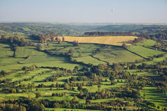 Aerial View of British Countryside. Aerial view of beautiful green countryside in Somerset, England. Includes fields, trees, golf course and a distant hot air stock photos