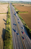 Aerial View of a British Motorway. Aerial view of moving traffic on the M4 motorway in Somerset, England Royalty Free Stock Images