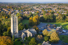 Aerial view of a British village with church and school. Aerial view of an English village featuring old church, small school and modern houses set in the Royalty Free Stock Photography