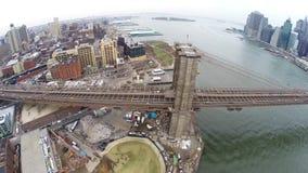 Aerial view of Brooklyn Bridge and Manhattan Bridge stock footage
